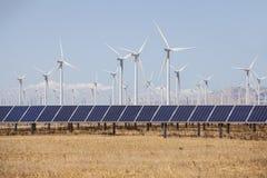 Molinos de viento de la energía alternativa y solar Foto de archivo libre de regalías