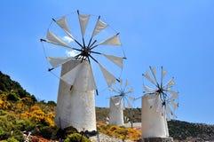 Molinos de viento en Crete Foto de archivo