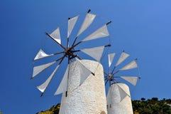 Molinos de viento en Crete Foto de archivo libre de regalías