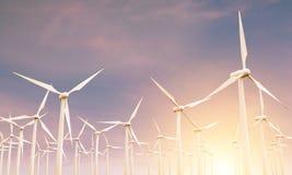 Molinos de viento en la puesta del sol Fotos de archivo libres de regalías