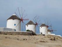 Molinos de viento viejos en Mykonos en Grecia Imágenes de archivo libres de regalías