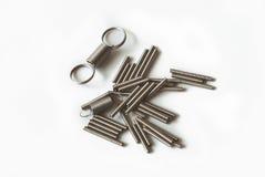 Molle d'acciaio di fondo bianco Fotografia Stock