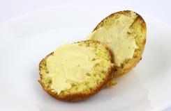 Molletes de maíz untados con mantequilla Foto de archivo