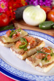 Molletes Mexican Dish. Which is a bolillo half sliced with fried beans and topped with cheese and pico de gallo salsa Stock Images