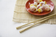 Molluscs on plate. With chopsticks Stock Images