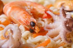 Mollusks and shrimps and Chinese noodles soup close up Stock Photography