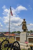 Molly Pitcher Standing with the USA  Flag. Carlisle, PA, USA – June 26, 2016: The Mary Ludwig Hays - better known as Molly Pitcher - gravesite, located in the Stock Photography