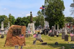 Molly Pitcher and USA Flags in Carlisle PA. Carlisle, PA, USA – June 26, 2016: The Mary Ludwig Hays - better known as Molly Pitcher - gravesite, located in the Royalty Free Stock Photography