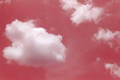 Moln i röd himmel Royaltyfri Foto