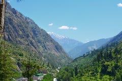 Molndal och grön sikt av berg royaltyfria foton