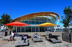 Molnet på Queenshamnplatsen i Auckland strand, Nya Zeeland Arkivbild