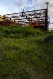 Molnig övergiven aftonsikt - rulla stålBenwood arbeten Fotografering för Bildbyråer