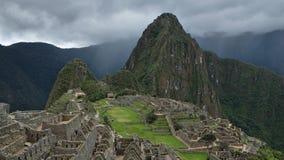 Molnig motning på Machu Picchu den arkeologiska platsen arkivfoto