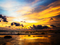 molnig solnedgång royaltyfri fotografi