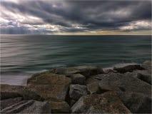 molnig solnedgång Fotografering för Bildbyråer