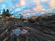 Molnig soluppgång på Pemaquid punkt, Maine royaltyfri foto