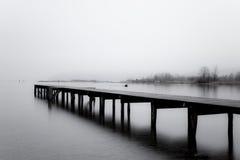 Molo di legno nel grey Immagini Stock
