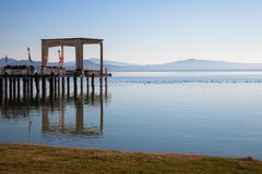Molo sul lago Trasimeno, Italia Fotografie Stock