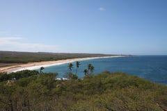 Molokai Hawaii Coast. A long sandy beach stretches along the west coast of the tropical island of Molokai Hawaii royalty free stock photos