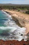 Molokai Hawaii Coastline with Resort. A resort among trees along the rugged west coast of the tropical island of Molokai Hawaii stock image