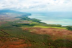 Molokai`s colorful coastline, as seen from a low-flying small airplane, in Hawaii. Aerial view of the colorful coastline and Pacific Ocean water of the Hawaiian Stock Photography