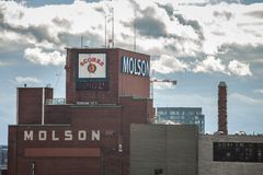 Molson Coors logo on Molson Brewery brick tower in downtown Montreal, Quebec. stock photos