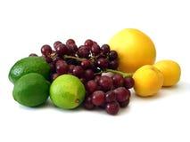 Molta frutta su bianco Immagini Stock