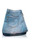 Molte blue jeans sul bianco. Fotografia Stock