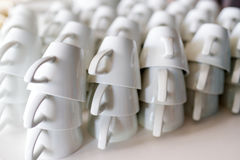 Molte file delle tazze di caffè macchiato pure Fotografia Stock