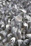 Molte mani che raggiungono fino alla gru a benna Fotografia Stock Libera da Diritti