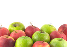 Molte mele mature come fondo isolato sulla c bianca Fotografia Stock
