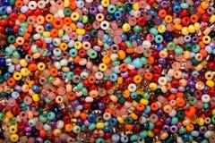 Molte perle sparse del seme Fotografia Stock