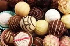 Molte praline del cioccolato di variet?, pralina gastronomica del cioccolato della confetteria belga fotografie stock libere da diritti