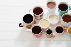 Molte tazze delle bevande calde Fotografie Stock