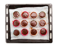 Molten chocolate cakes on a baking tray Royalty Free Stock Images