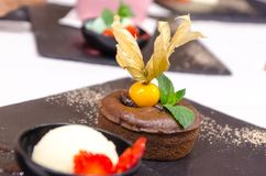 Coulant, molten chocolate with vanilla and ice cream Royalty Free Stock Image