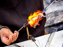 Molten glass. Glassblower forms a whirling dervish from molten glass Royalty Free Stock Photography
