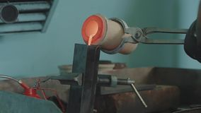 Molten Gold being poured into Ingot moulds. Molten Gold being poured into Ingot moulds. Casting metal or gold being stock footage