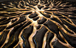 Molten Gold Seeping Out Of Rock Stock Photography