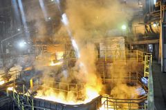 Molten hot steel pouring Royalty Free Stock Photos