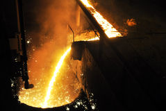 Molten iron is poured through a chute Royalty Free Stock Photography