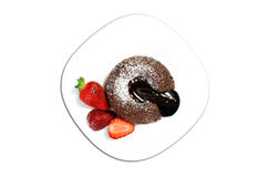 Molten Lava Cake. Molten Chocolate Lava Cake with strawberry Royalty Free Stock Photo