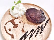 Molten lava chocolate cake with whipping cream Royalty Free Stock Photo