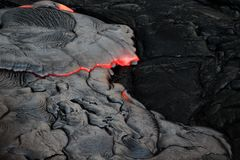 Molten lava crusts over and solidifies very quickly royalty free stock images