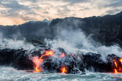 Molten Lava Flowing Into The Pacific Ocean Royalty Free Stock Photos