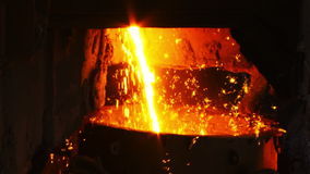 Molten metal flows into the bucket stock footage