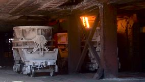 Molten metal pouring out of furnace. Liquid metal from blast furnace. Molten metal foundry stock video