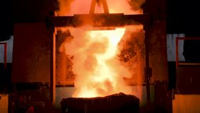 Molten metal pouring out of furnace. Liquid metal from blast furnace stock video