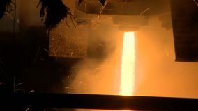Molten metal pouring out of furnace. Liquid metal from blast furnace stock video footage