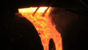 Molten metal start pouring from blast furnace. Metallurgical industry